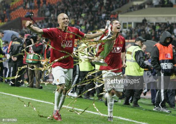 Manchester United's Wes Brown and Cristiano Ronaldo run with the trophy after beating Chelsea in the final of the UEFA Champions League football...
