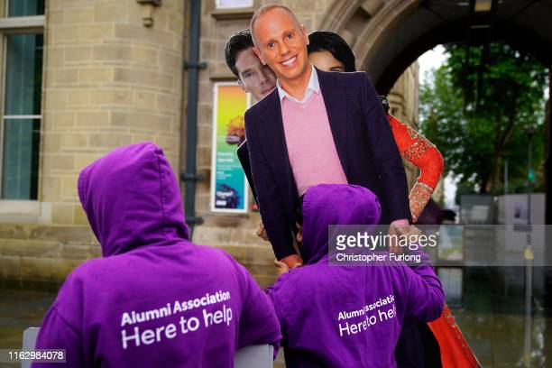Manchester University students carry carboard cutouts of former students Robert Rinder also known as Judge Rinder and Benedict Cumberbatch on...