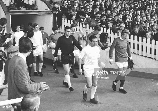 Manchester Utd and Real Madrid being led onto the field by their captains Denis Law and Francisco Gento respectively