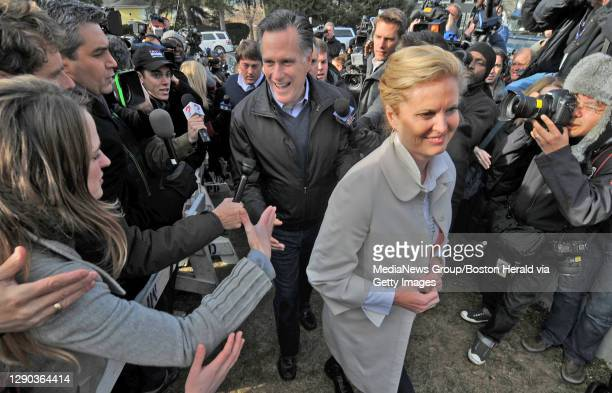 Manchester,NH -Candidate Mitt Romney greets supporters as his wife Ann looks on during a visit to the Webster School in Manchester 011012. Staff...