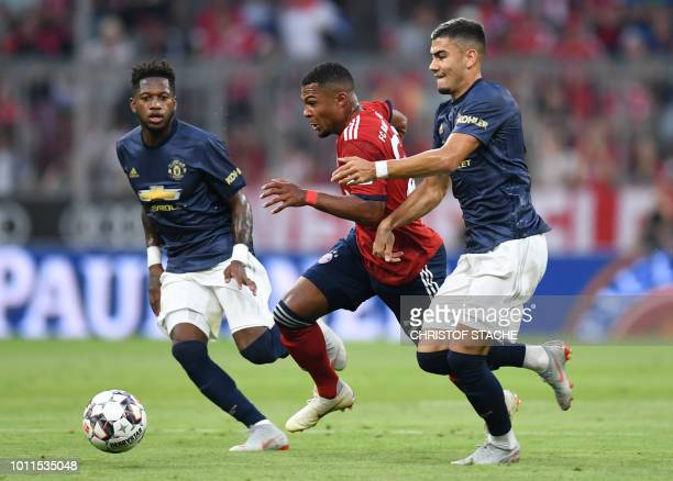 Manchester's Brazilian Fred Bayern Munich's midfielder Serge Gnabry and Manchester's Belgian midfielder Andreas Pereira vie for the ball during the...