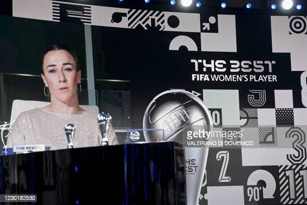 Manchester's British defender Lucy Bronze appears on a screen to give a speech after receiving The Best FIFA Women's player award during The Best...