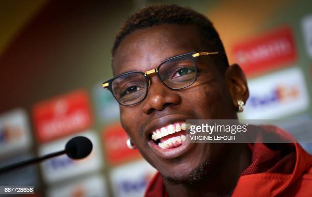 Manchester's French midfielder Paul Pogba takes part in a press conference during on April 12 2017 on the eve of the Europa League football match...