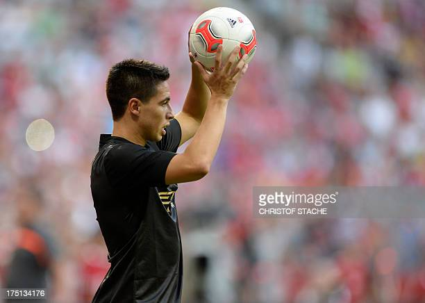 Manchester's French midfielder Samir Nasri throws the ball during the Audi Cup football match Manchester City vs AC Mailand in Munich southern...