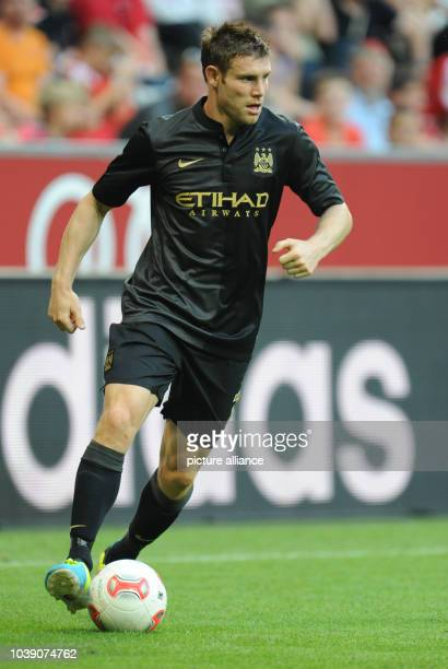Manchester's James Milner runs with the ball during the Audi Cup soccer semifinal match Manchester City vs AC Milan at Allianz Arena in Munich...