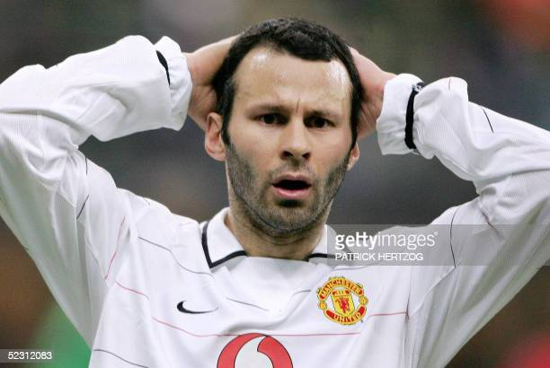 Manchester's midfielder Ryan Giggs reacts against AC Milan during their Champions League 2nd leg football match at San Siro stadium in Milan 08 March...