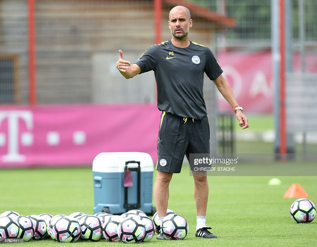 Manchester's new Spanish headcoach Pep Guardiola attends a training session of Manchester City at the training ground of the German first division football team FC Bayern Munich in Munich, southern Germany, on July 21, 2016. / AFP / CHRISTOF