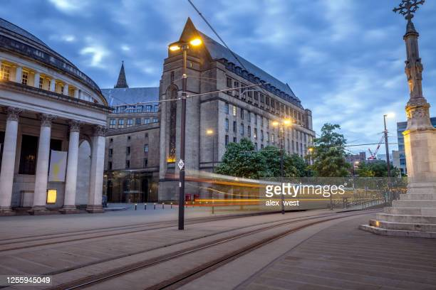 manchester's st peters square with city tram. - town hall stock pictures, royalty-free photos & images