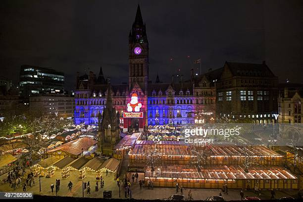 Manchester's Town Hall is illuminated in blue white and red lights resembling the colours of the French national flag in Manchester north west...