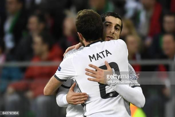 Manchester's United's Armenian forward Henrikh Mkhitaryan celebrates with teammate Spanish midfielder Juan Mata after scoring a goal during the UEFA...