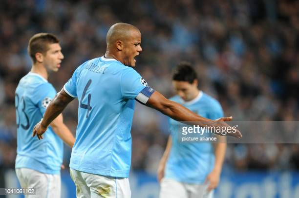 Manchester's Vincent Kompany and Matija Nastasi_ during the Champions League Group D match between ManchesterCity and FCBayern Munich at the City...