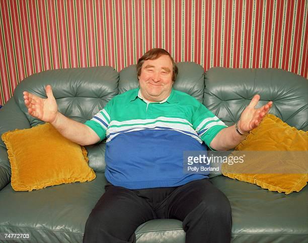 Mancunian standup comedian Bernard Manning gestures expansively circa 1997
