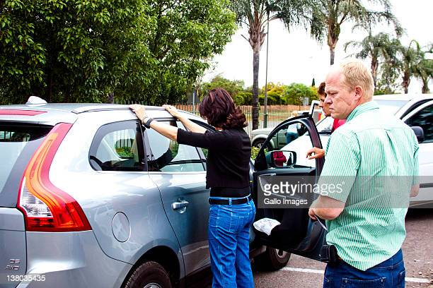 Manda Reyneke places her hands on the roof of a car as she is arrested on November 18, 2010 in Pretoria, South Africa. Manda Reyneke received a three...
