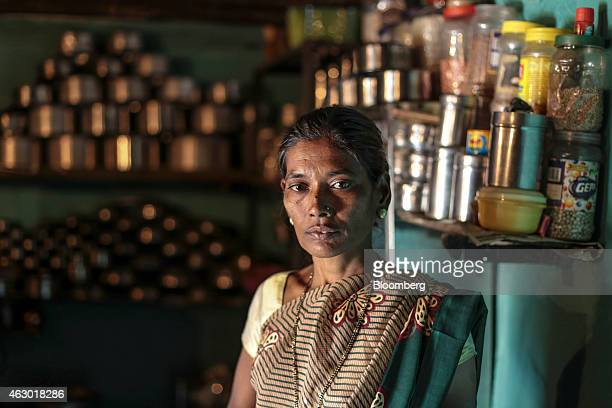 Manda Shastrakar whose husband committed suicide by setting himself on fire poses for a photograph inside her house in Yavatmal Maharashtra India on...