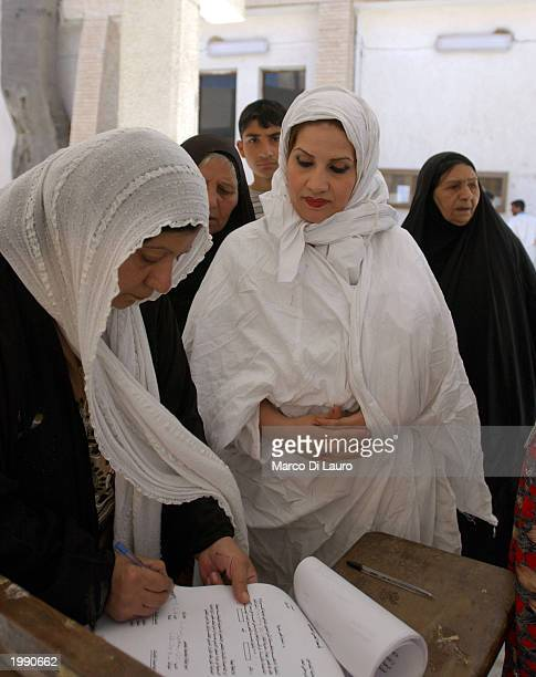 Mandaean Sabian follower 26yearold Intithar Manssur prepares to sign a baptism certificate before her postnuptial baptism one day after her marriage...