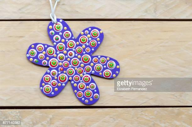 Mandala with flower shape on wooden background