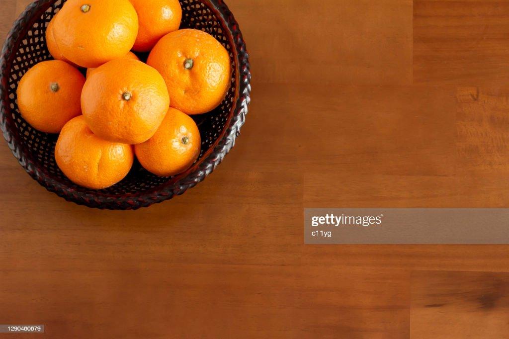 Mandarin oranges placed on the kotatsu : Stock Photo