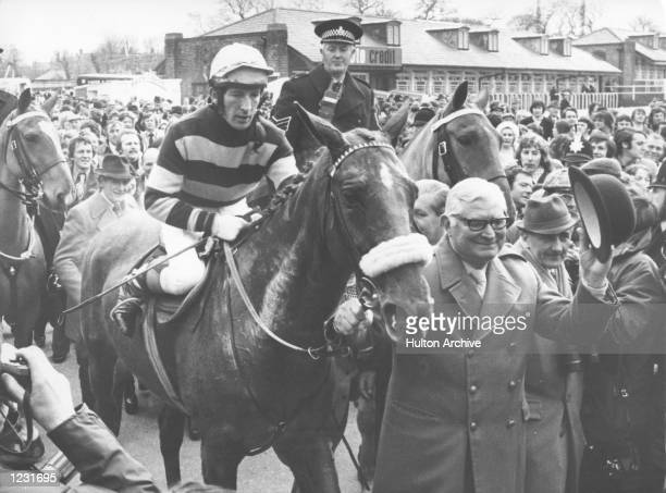 L''ESCARGOT RIDDEN BY J CARBERRY IS LED IN BY OWNER RAYMOND GUEST AFTER WINNING THE GRAND NATIONAL AT AINTREE RACECOURSE RED RUM CAME SECOND AND...