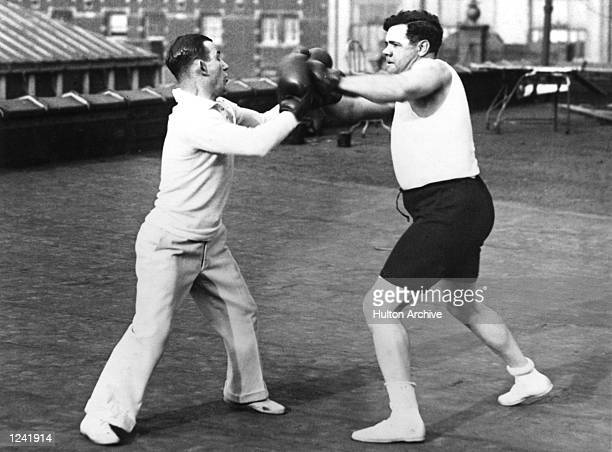 IN TRAINING FOR THE START OF THE 1926 BASEBALL SEASON BOXES WITH PROFESSOR ARTHUR MCGOVERN AT THE MCGOVERN GYMNASIUM IN NEW YORK CITY Mandatory...