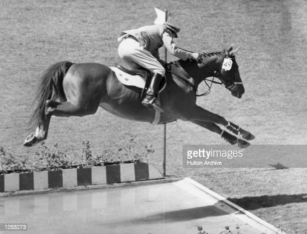 D''INZEO WHO HAD WON A GOLD MEDAL EARLIER IN THE OLYMPIC INDIVIDUAL SHOW JUMPING SEEN TAKING THE LONG WATER JUMP IN THE TEAM EVENT AT THE OLYMPIC...