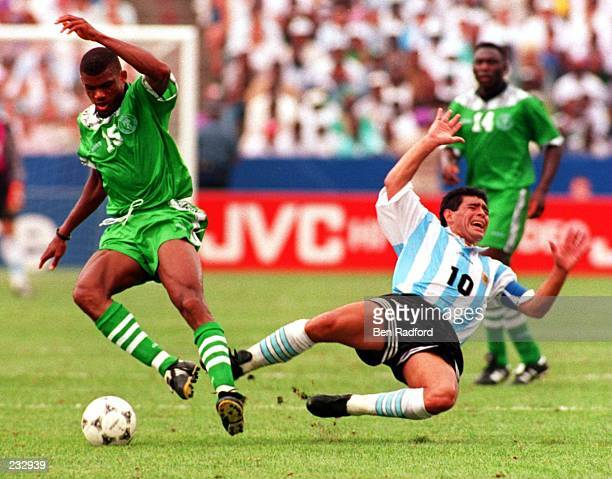 NIGERIA''S SUNDAY OLISEH STRIPS THE BALL AWAY FROM A FALLING DIEGO MARADONA DURING THE SECONDHALF AT FOXBORO STADIUM IN FOXBORO MASSACHUSETTS THE...