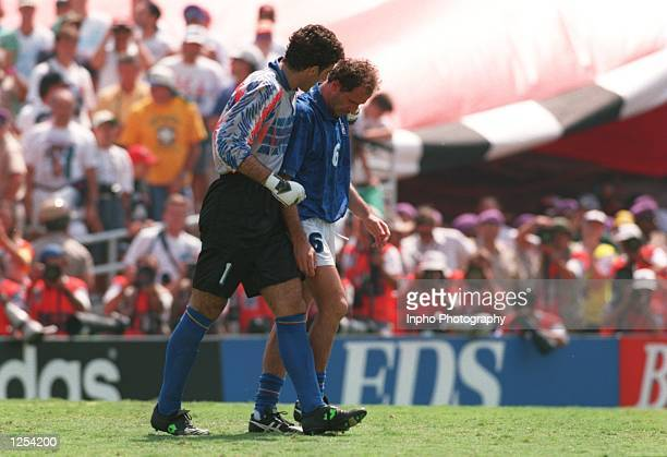 AND FRANCO BARESI OF ITALY LEAVE THE FIELD AFTER LOSING TO BRAZIL IN THE PENALTY SHOOTOUT DURING THE 1994 WORLD CUP FINAL MATCH AT THE ROSE BOWL IN...