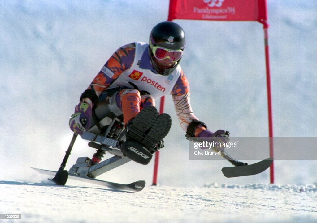 SWEEPS PAST A GATE ON HIS SPECIALLLY-ADAPTED SKIS DURING THE MENS SUPER-GIANT SLALOM OF THE 6TH WINTER PARALYMPICS AT LILLEHAMMER, NORWAY. Mandatory Credit: Clive Brunskill/ALLSPORT