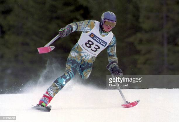 USES HIS SPECIALLYADAPTED POLES TO KEEP HIS BALANCE DURING THE MENS GIANT SLALOM AT THE 6TH WINTER PARALYMPICS TODAY MILTON WON THE GOLD IN THE LW2...
