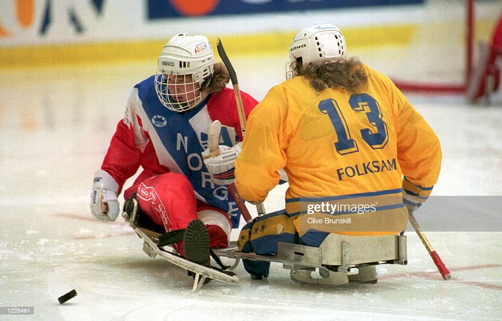 AND JENS KASK (SWEDEN) CLASH DURING THE ICE SLEDGE HOCKEY FINAL AT THE 6TH WINTER PARALYMPICS TODAY. SWEDEN BEAT NORWAY 1-0 TO WIN THE GOLD. Mandatory Credit: Clive Brunskill/ALLSPORT