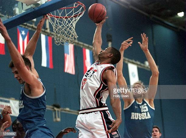 OF THE OF RUSSIA REACHES ATTEMPTS TO BLOCK AN ALAN HENDERSON DUNK DURING THE TEAM BASKETBALL TOURNAMENT AT THE 1994 GOODWILL GAMES IN ST PETERSBURG...