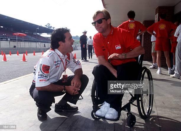 ENJOYS A JOKE WITH THREE TIMES WORLD CHAMPION WAYNE RAINEY PRIOR TO PRACTICE IN THE1995 AUSTRALIAN MOTORCYCLE GRAND PRIX AT EASTERN CREEK SYDNEY...