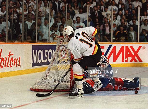 CANUCK''S PAVEL BURE DURING A PENALTY SHOT TONIGHT DURING THE SECOND PERIOD OF GAME FOUR OF THE STANLEY CUP FINALS AT THE PACIFIC COLISEUM IN...