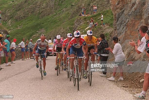 AND MARCO PANTINI OF ITALY AS THEY CLIMB THE COL DE LA CROIX DE FER IN TODAYS MOUNTAIN STAGE FROM AIMELA PLAGNE TO L`ALPED`HUEZ OF 1625KM PANTANI...
