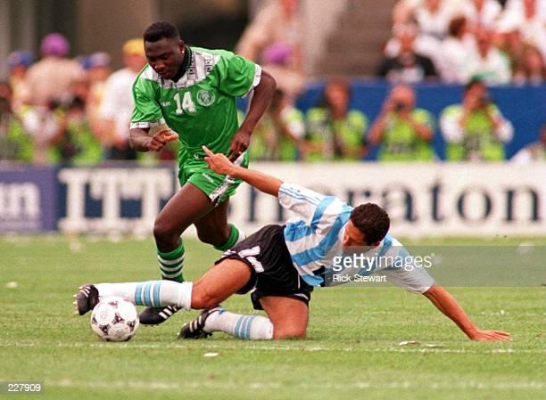 TRIES TO KEEP THE BALL AWAY FROM NIGERIA''S DANIEL AMOKACHI DURING THE 1994 WORLD CUP AT FOXBORO STADIUM IN FOXBORO MASSACHUSETTS Mandatory Credit...