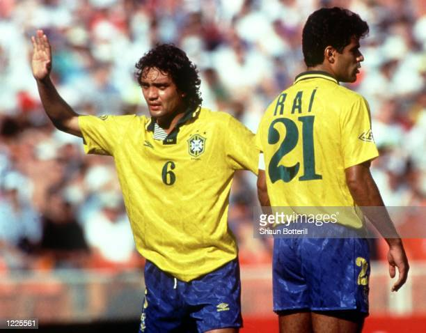 OF THE NATIONAL SOCCER TEAM OF BRAZIL GESTICULATES WITH HIS RIGHT HAND AS TEAMMATE RAI TURNS HIS BACK DURING A WORLD CUP QUALIFYING MATCH IN 1993...