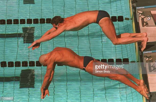AND RENE GUSPERTI OF ITALY DIVE OFF THE BLOCKS AT THE START OF HEAT SEVEN IN THE MENS 50 METRE FREESTYLE AT THE WORLD SWIMMING CHAMPIONSHIPS IN ROME...