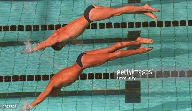 AND RENE GUSPERTI OF ITALY DIVE INTO THE WATER AT THE START OF HEAT SEVEN IN THE MENS 50 METRE FREESTYLE AT THE WORLD SWIMMING CHAMPIONSHIPS IN ROME...