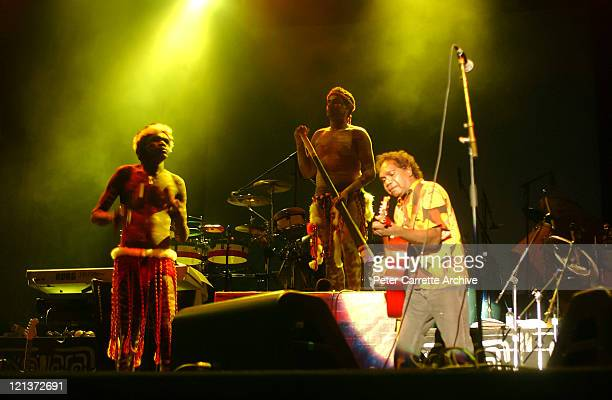 Mandawuy Yunupingu with the band Yothu Yindi performing on stage as the opening act for Carlos Santana during his 'Shaman' concert tour at Centennial...