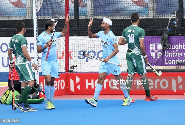 Mandeep Singh of India celebrates scoring their teams third goal with teammates during the 5th8th place match between Pakistan and India on day eight...