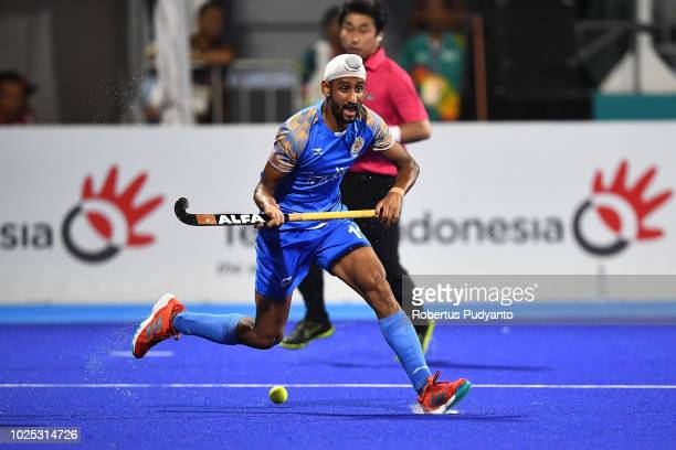 Mandeep Singh of India shoots during Men's Hockey Semifinal match between Malaysia and India at GBK Senayan on day twelve of the Asian Games on...