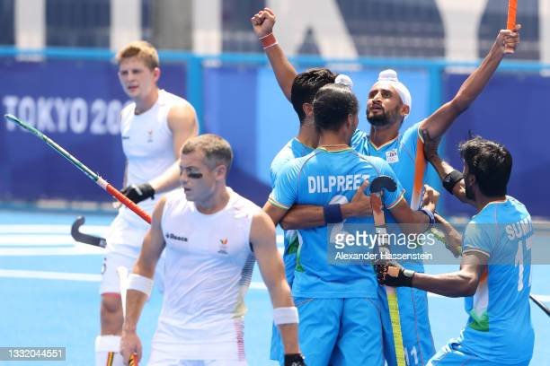 Mandeep Singh of Team India celebrates scoring the second goal with Dilpreet Singh and Sumit during the Men's Semifinal match between India and...