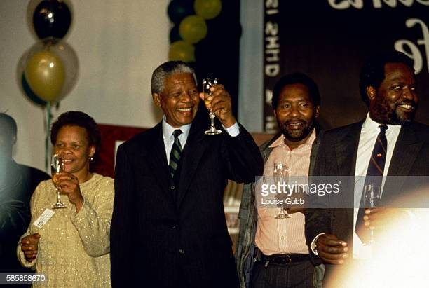 Mandela celebrates the ANC victory in South Africa's first Democratic elections since the end of apartheid Mandela is with the widow of assassinated...