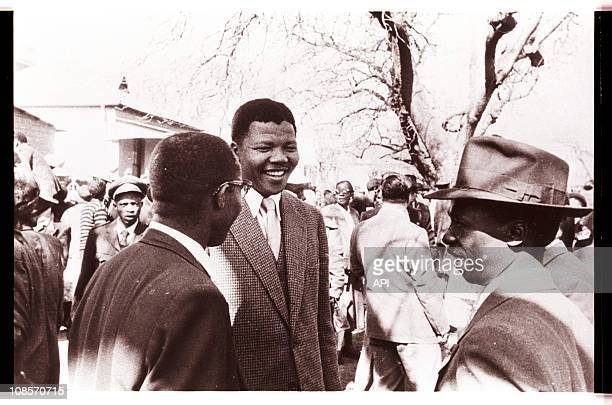 Mandela speaking with codefendants outside the Treason Trial late 1950's in South Africa