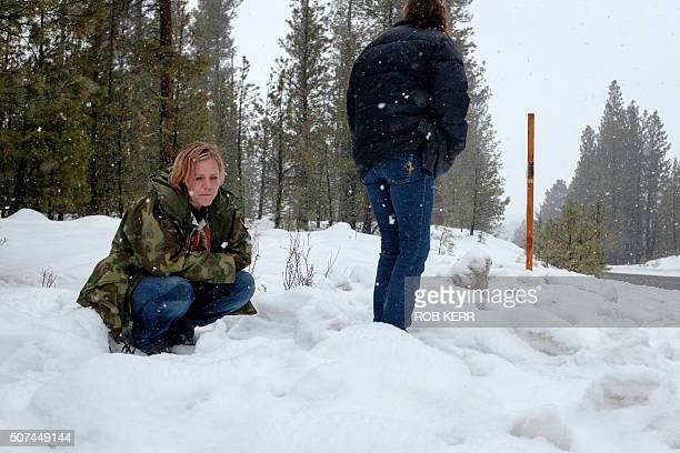 Mandi Jacobs and Jenna Lynn react on Highway 395 near Burns Oregon on January 29 at the location where Robert LaVoy Finicum was shot dead and others...