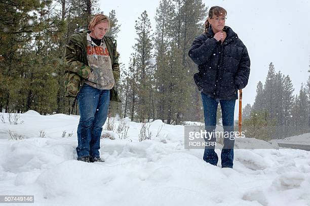 Mandi Jacobs and Jenna Lynn react on Highway 395 near Burns Oregon on January 29 at the location where Robert 'LaVoy' Finicum was shot dead and...