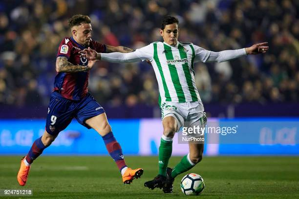 Mandi of Real Betis Balompie competes for the ball with Roger of Levante UD during the La Liga match between Levante UD and Real Betis at Ciutat de...