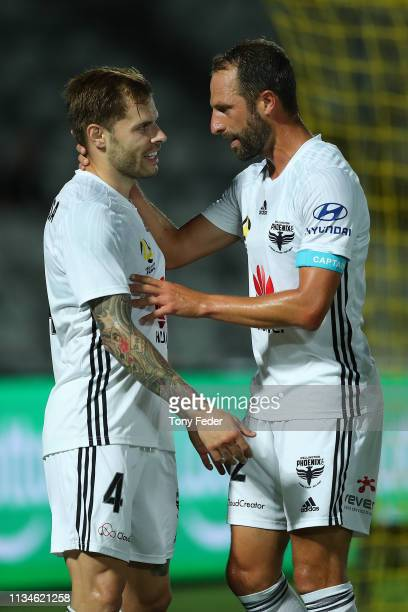 Mandi Sosa of Wellington Phoenix celebrates a goal with team mate Andrew Durante during the round 21 ALeague match between the Central Coast Mariners...