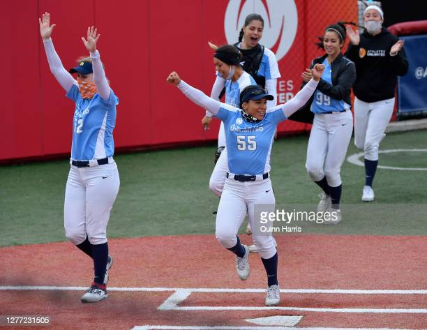 Mandie Perez of Team Piancastelli celebrates after a home run in the fifth inning against Team Ocasio during the final weekend of the Athletes...