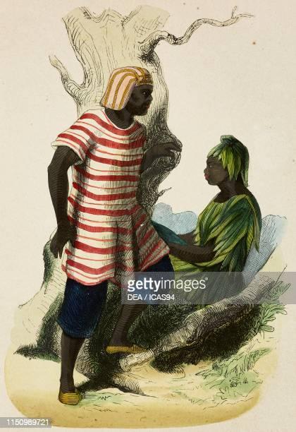Mandingo and woman of Cazegut West Coast of Africa coloured engraving from Les moeurs et costumes de tous les peuples Afrique by Casimir Henricy and...