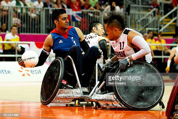 Mandip Sehmi of Great Britain is put under pressure from Shin Nakazato of Japan during the Men's Pool Phase Group A match between Great Britain and...